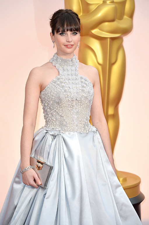 Felicity Jones arrives on the red carpet at the 87th Academy Awards at the Hollywood & Highland Center in Los Angeles on February 22, 2015. Photo by Kevin Dietsch/UPI Photo via Newscom