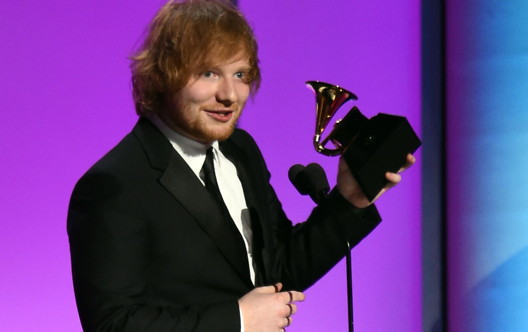 Feb 15, 2016; Los Angeles, CA, USA; Ed Sheeran accepts for Thinking Out Loud in Best Pop Solo Performance during the 58th Grammy Awards at the Staples Center. Mandatory Credit: Robert Hanashiro-USA TODAY NETWORK *** Please Use Credit from Credit Field ***